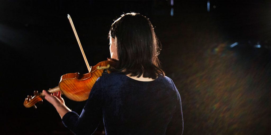 back of Leslie playing the violin
