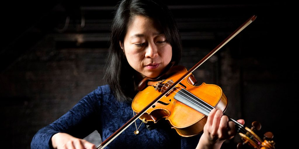 Closeup of Leslie playing the violin