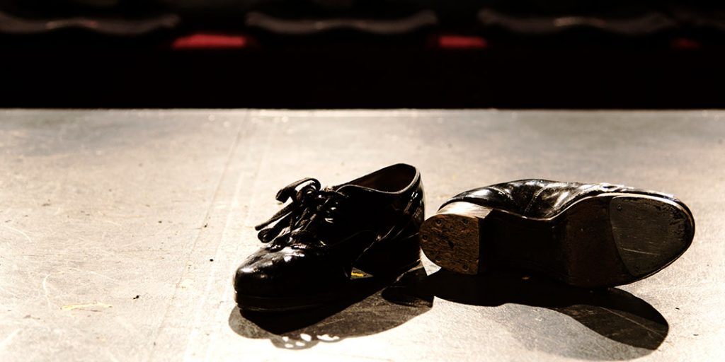 tap shoes on an empty stage
