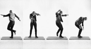 Four vertical images next to eachother capture dancer Travis Knights mid-dance