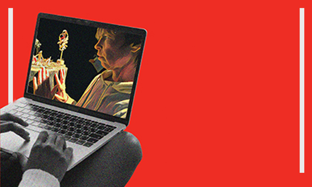 hands are resting on a Mac computer as the screen shows excerpts from Alex Bulmer in May I take your arm? Graphic is red with white lines on each side.